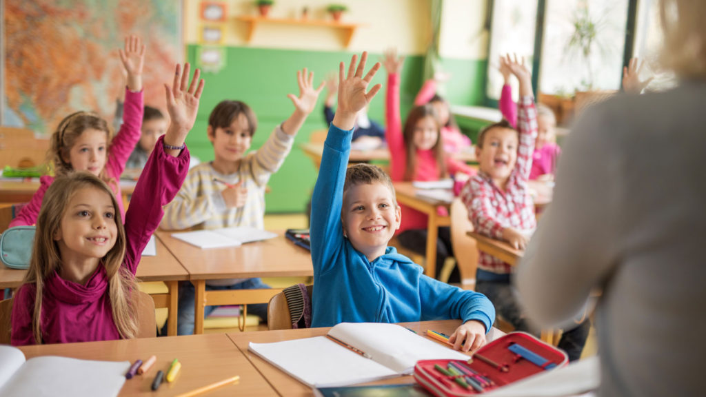 school-children-raising-their-hands-ready-to-answer-the-question-000069014059_xxxlarge